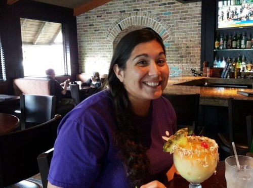 Danica, an LAC Therapist, enjoys a pina colada with coworkers.