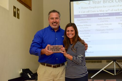 Natalie Donkersloot celebrating 2 years at Lighthouse Autism Center with Executive Director Gregg Maggioli and getting enrolled into the employee stock ownership plan.